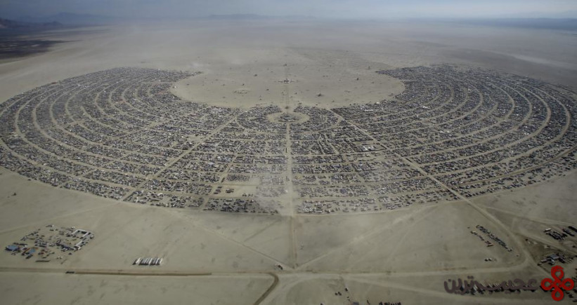 """An aerial view of Burning Man 2015 """"Carnival of Mirrors"""" arts and music festival in the Black Rock Desert of Nevada"""
