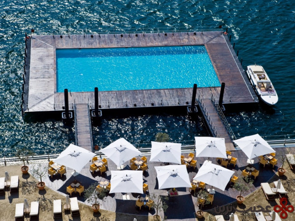 the grand hotel tremezzo in tremezzina, italy, features a floating pool that sits right in the waters of lake como, giving guests the option of a dip in the p