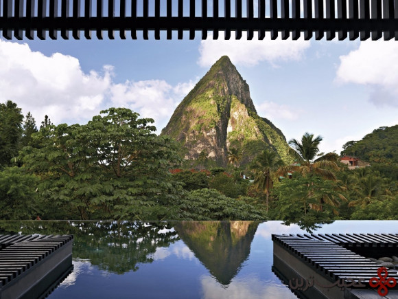 the black quartz infinity pool at hotel chocolat on the island of st lucia provides guests with quite the view thanks to its location across from petit piton