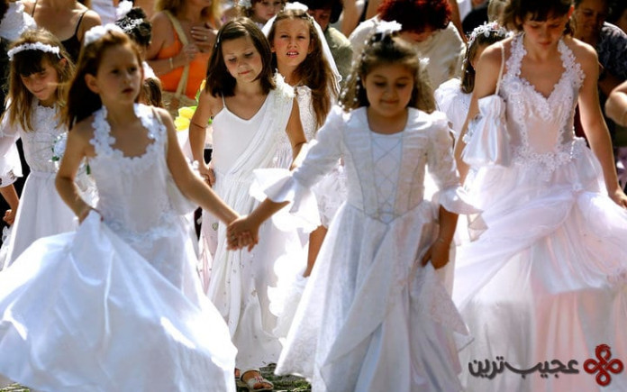 girls dressed in wedding dress attend the celebrations of eniovden in the town of asenovgrad